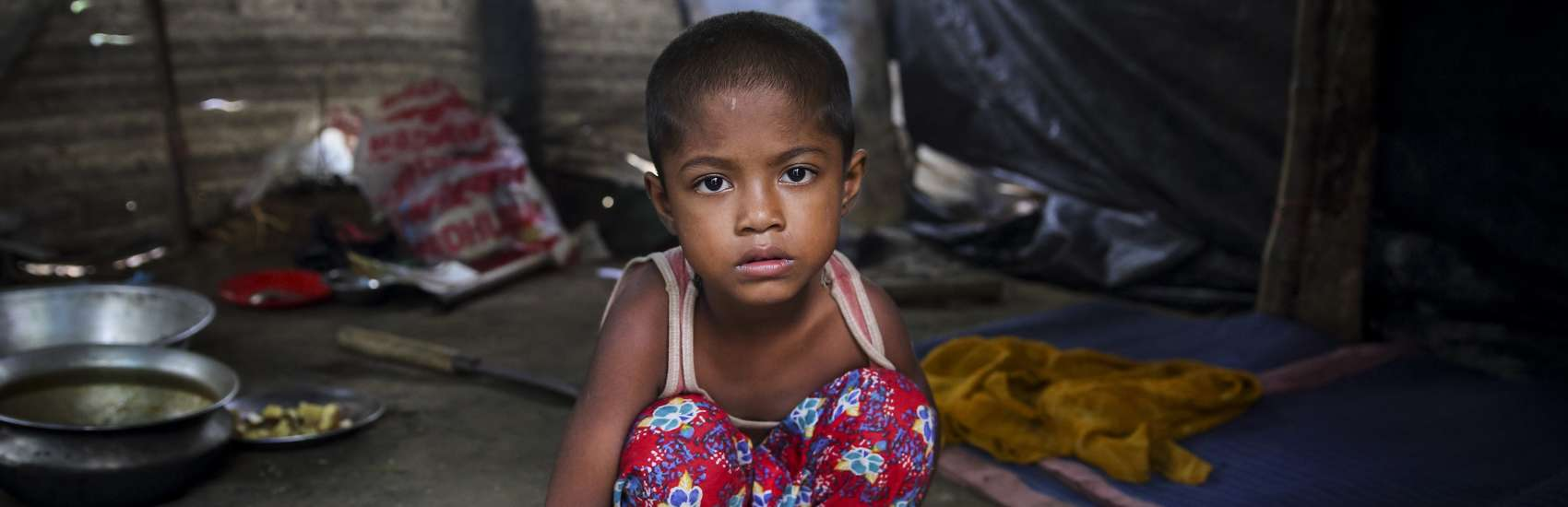 This five-year-old girl fled Myanmar with her family when their village was attacked. They're now living in a makeshift camp in Bangladesh. Children account for some 60% of the Rohingyas who've arrived in Bangladesh since the sudden and rapid escalation of violence in Myanmar. Photo Credit: GMB Akash/Save the Children, October 2017.