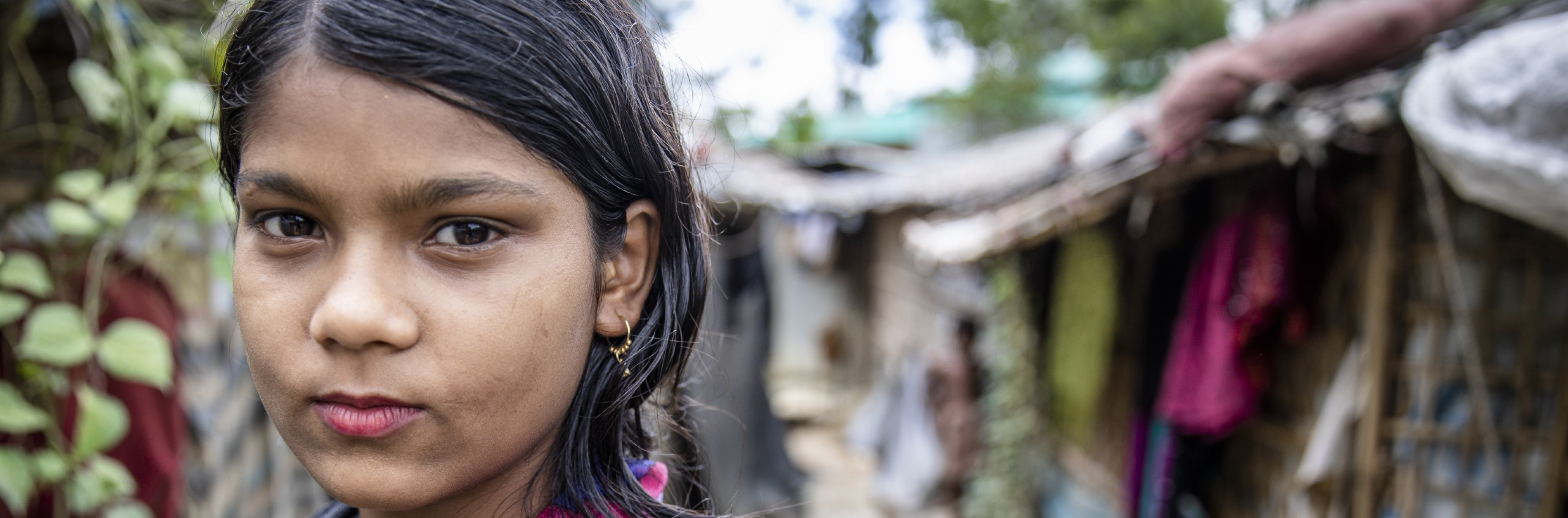 Marium*, 11, stands near her home in a camp for Rohingya Refugees in Cox's Bazar, Bangladesh.