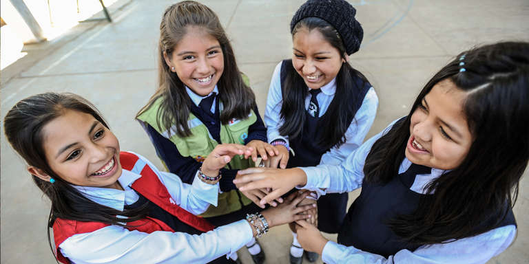 Girls attend the Martin Cardenas School in Cochabamba, Bolivia, a school supported by Save the Children sponsorship programs. Photo Credit: Susan Warner/Save the Children 2015.