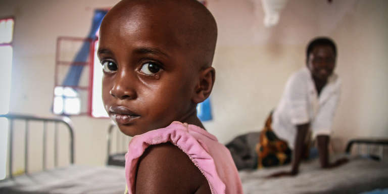 Leice, a 3-year-old is being treated for typhoid fever at a Save the Children Health Center in a refugee camp. Photo credit: Mark Kaye/Save the Children, August 2016.