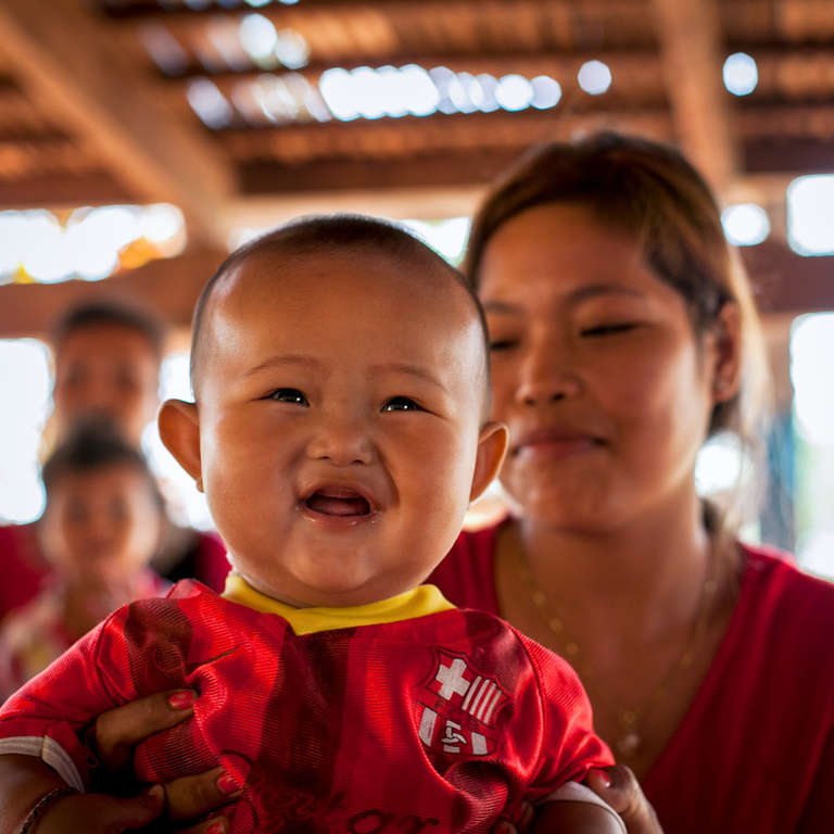 A big smile from 6-month-old baby boy who has been exclusively breast-fed by his mother in Cambodia. Save the Children aims to help by increasing accessibility, utilization and quality of health services, improving health practices and increasing the demand for maternal and child health services by the community. Photo Credit: KJ Borja / Save the Children, March 2013.