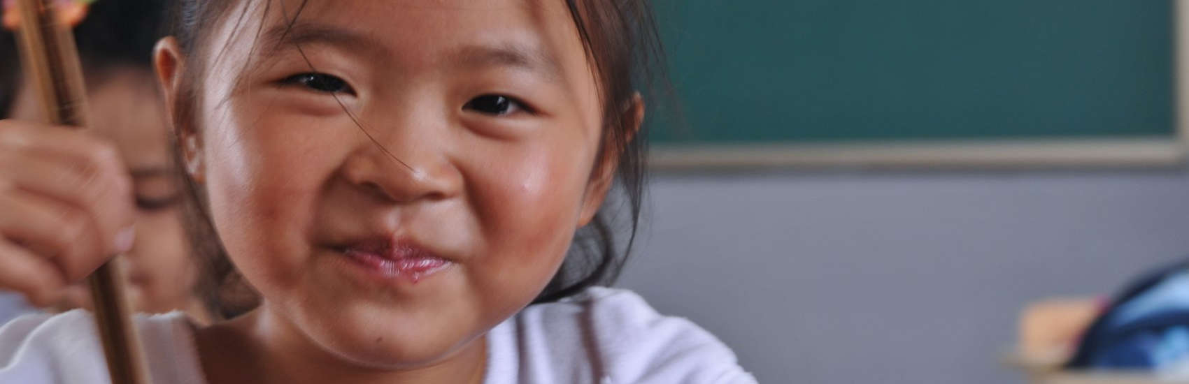 "A schoolgirl in Shanghai, eats with her chopsticks during ""Mr. Broccoli,"" a Save the Children program done in partnership with IKEA. Photo credit: Save the Children, October 2011."