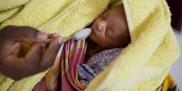 An eleven-day-old baby is cared for with help from a grant from the Bill and Melinda Gates Foundation. The babies were born one week premature and one weighed 4.1 pounds and the other 4.4 pounds. Photo Credit: Joshua Roberts/Save the Children 2010