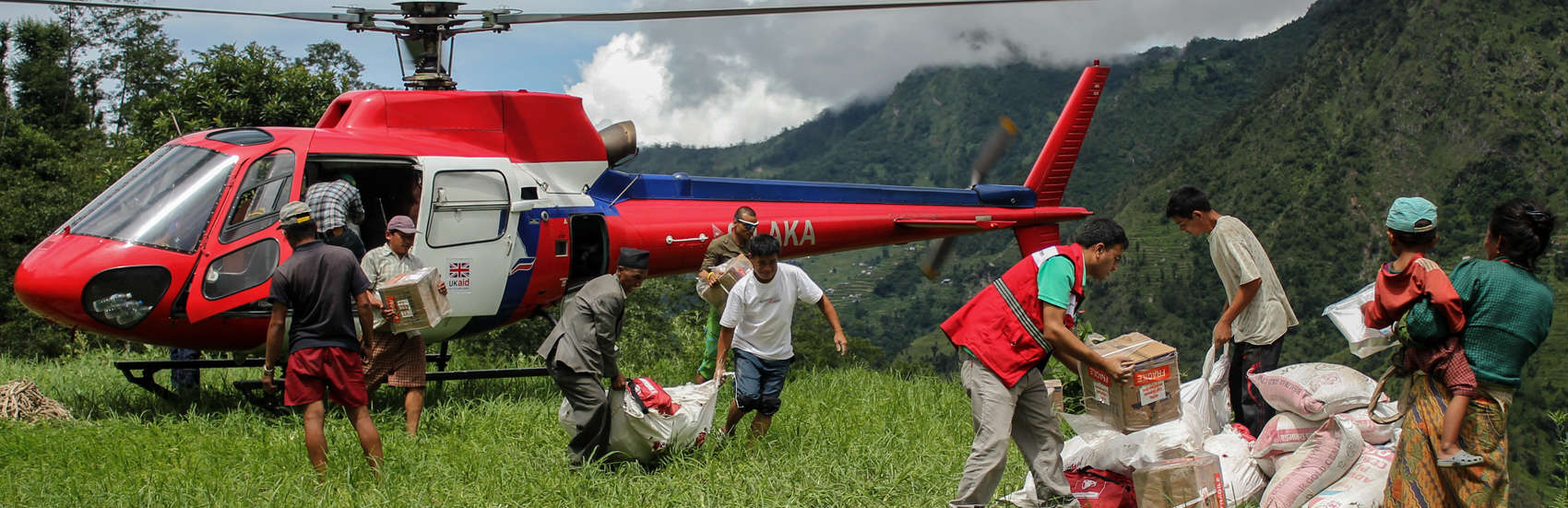 An emergency response team delivers shelter and WASH supplies via Helicopter during an emergency.