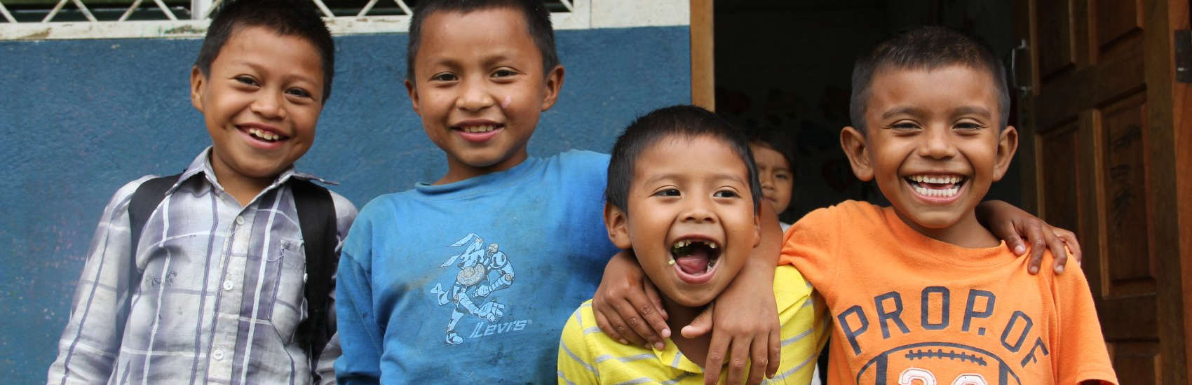 A young boy, Lesbi and his three friends put their arms around each other and smile for the camera at a Save the Children-sponsored school in the mountains of Nicaragua. Photo credit: Save the Children, June 2014.
