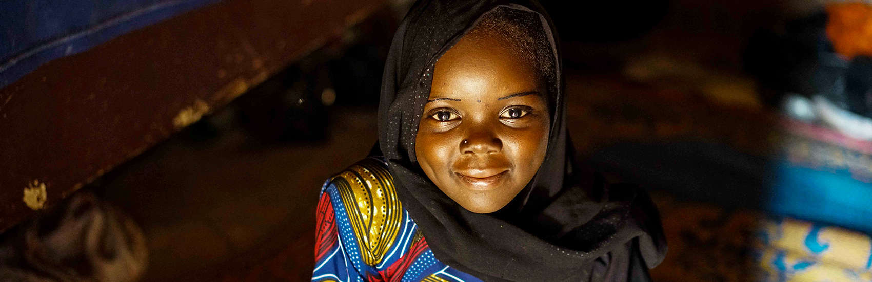 A young girl smiles because she is happy to be the first sponsorship child in the Tessaoua region of Niger. Photo Credit: Talitha Brauer/Save the Children 2016.