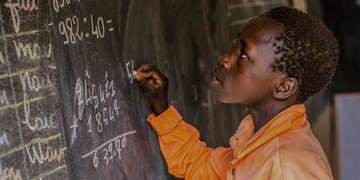 13-year-old Kabirou solves a math problem during a basic education lesson in mathematics in Niger. Photo Credit: Victoria Zegler/Save the Children 2016