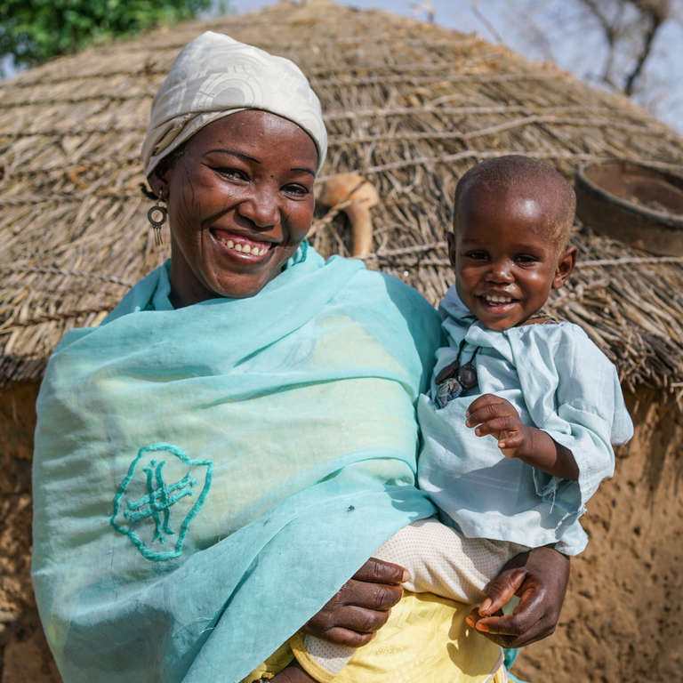 Rabiou and mother Fatima at home in their village in Niger. Photo Credit: Talitha Brauer/Save the Children, 2016.