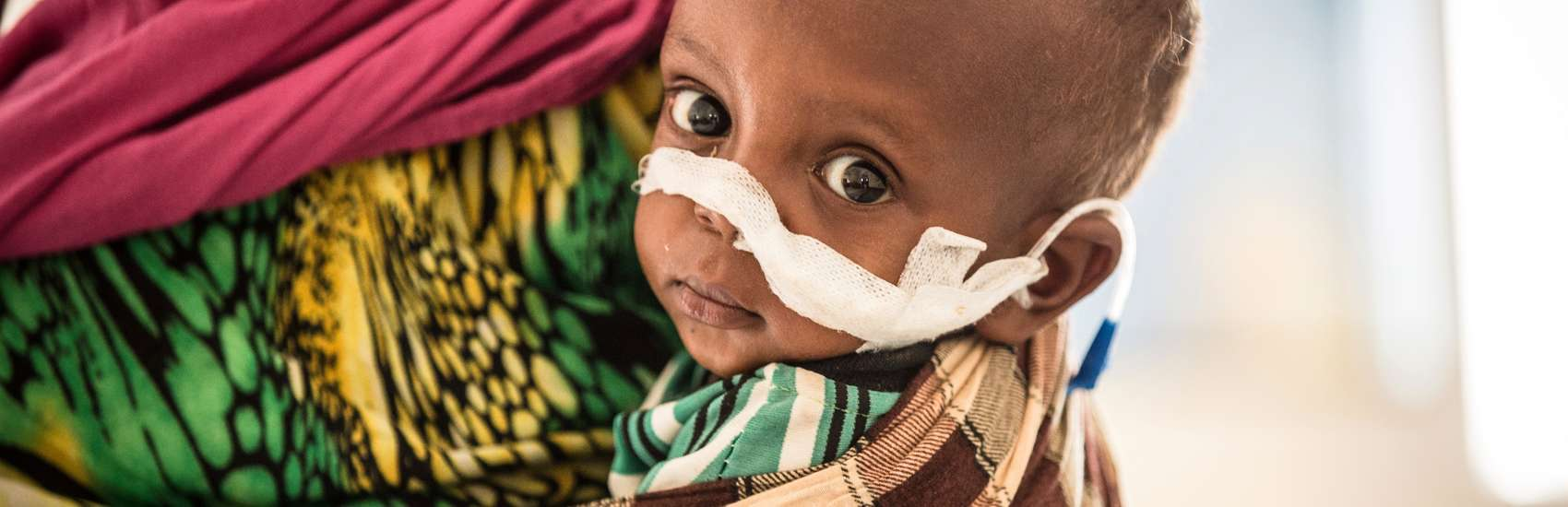 A 22-month-old boy and his mother recovers from malnutrition in the stabilization centre in a hospital in Somaliland. Photo Credit: Save the Children 2016.