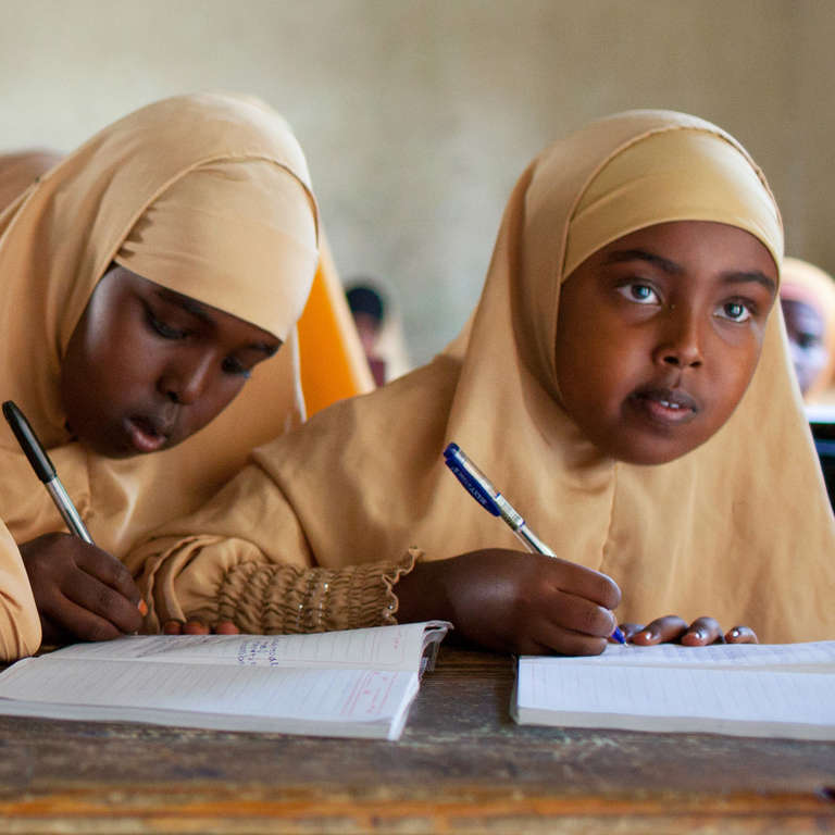 Girls in their 6th grade class taught by Fatuma Samatar in Borama, Somaliland. Fatuma specializes in Maths and Physics, but currently teaches Geography and Islamic Studies in 5th and 6th grades because of the shortage of teachers in these subjects. Photo Credit: Anna Kari/Save the Children 2012.