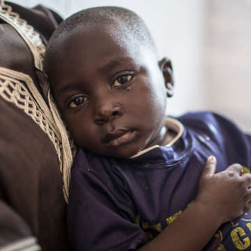 Tiny Joseph, in the arms of his mother, Viola. After fleeing South Sudan, Joseph had chest pain, a fever and was coughing. His mother brought him to a Save the Children Emergency Health Unit where he was treated with lifesaving antibiotics. Photo credit: Guilhem Alandry/Save the Children, March 2017.