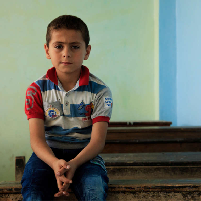 Rami*, 9, at a Save the Children-supported school in northern Syria. Rami* and his family were forced to flee their home in Syria due to the conflict. Photo credit: Ahmad Baroudi/Save the Children 2015.