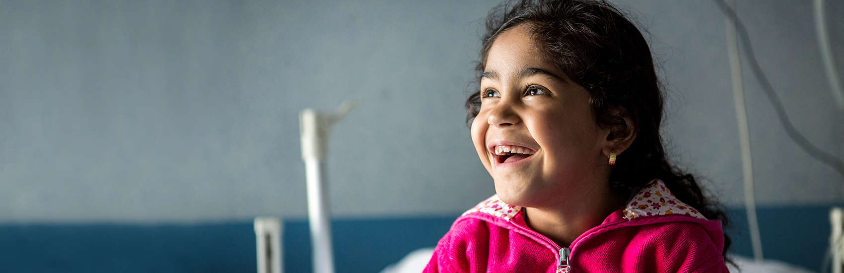 Amena*, five, from Syria, plays in her hospital bedroom where she was treated for asthma after being rescued by the Save the Children vessel in the Mediterranean Sea, Catania, Sicily, Italy. Photo credit: Louis Leeson / Save the Children 2016.