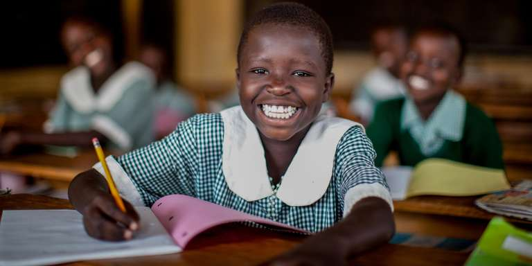A girl of 9 studies at her school in Uganda. Photo Credit: Jordan J. Hay/Save the Children 2012.
