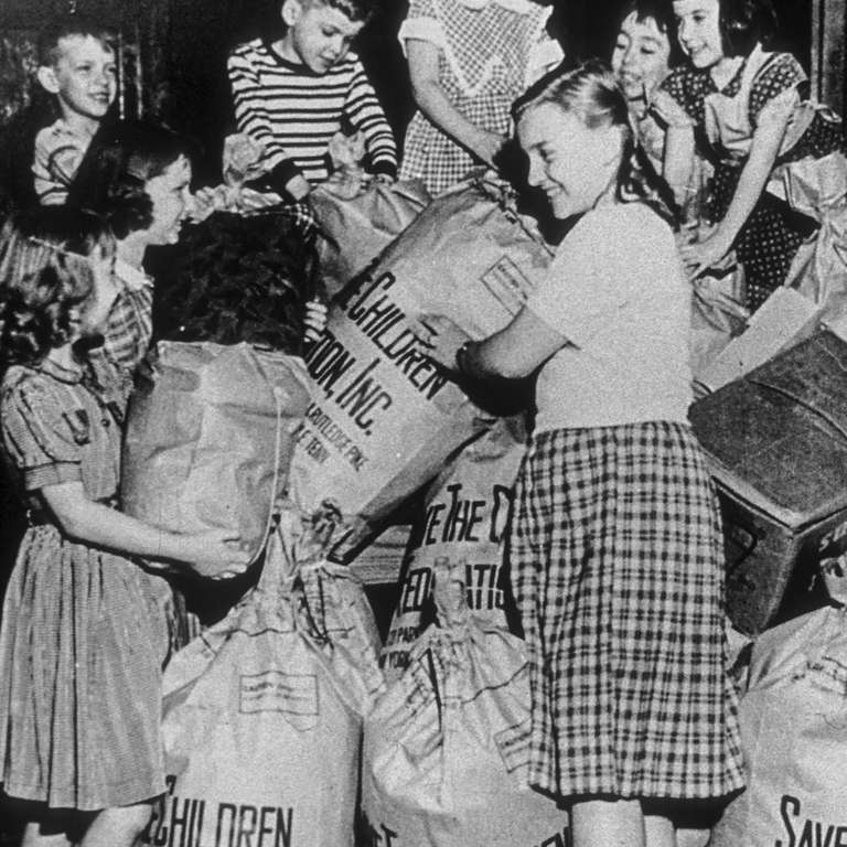 "Save the Children's first annual ""Bundle Days"" campaign was organized in Knoxville, Tennessee 1941, where volunteers refurbished and distributed donated clothing to needy children in the United States and war-affected Europe. Photo Credit Save the Children Archive 1941."