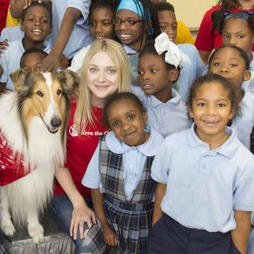 "Save the Children's animal ambassador Dakota Fanning joins children at a special Katrina-anniversary ""Prep Rally"" for New Orleans children at Treme Community Center in New Orleans, Louisiana. Photo Credit: Lee Celano/Save the Children 2015."