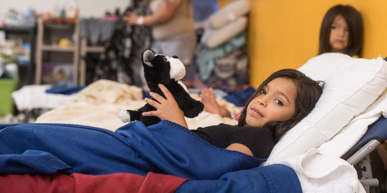 A 9 year-old girl is of 16 extended family members who evacuated together to the shelter for hurricane Harvey. All the children have been attending the Save the Children child-friendly space set up in the shelter. Photo Credit: Susan Warner/Save the Children 2017.