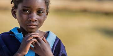 This little girl in Zambia is in the second grade and is enrolled in a school supported by Save the Children. Photo Credit: Victoria Zegler/Save the Children 2016