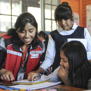 Delia, who was sponsored herself as a little girl, mentors two students at a Save the Children supported school in Bolivia. Photo credit: Save the Children, 2015.