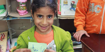 Girls like Rania in Egypt learn how to express themselves in our early learning centers, including how to write their own names. Photo credit: Save the Children.