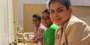 Children children in Egypt wash their hands school. Photo Credit: Save the Children 2016.