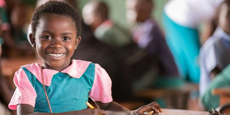A sponsored schoolgirl in Malawi learns math in a classroom. Photo credit: Malumbo Simwaka/Save the Children, July 2016.