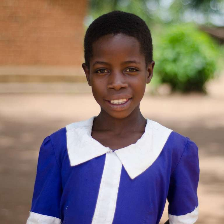 Young Blandhina in Malawi loves learning, thanks to a Save the Children Child Sponsorship program. She wants to be a radio announcer one day. Photo Credit: Save the Children in Malawi