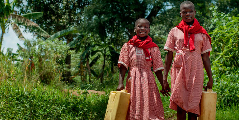 Girls in Uganda participate in a buddy system that ensures they remain safe while fetching water in remote locations. Photo credit: Rick D'Elia/Save the Children.