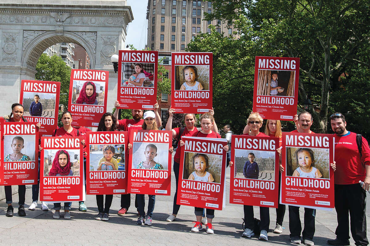 Save the Children employees in Washington Square park on international children's day in New York City. Save the Children staff went to various public places in New York with signs detailing the various ways in which children are missing out on their childhood. The goal was to start dialogue with New Yorkers about why childhood for some children is ending too soon. Photo credit: Ellery Lamm / Save the Children 2018.