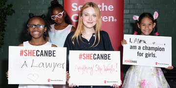 Dakota Fanning poses for pictures for the International Day of the Girl. Photo credit: Save the Children 2018.