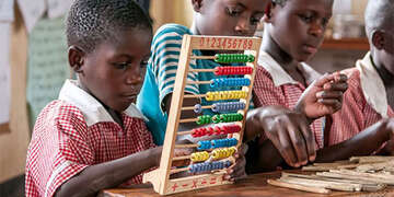 Student learns math on an abacus