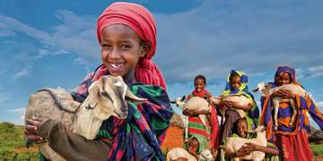 A young Ethiopian girl holds her precious goat to support the Save the Children Gift Catalog. Photo Credit: Gary Dowd/Save the Children 2010.