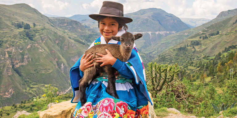 When you support Save the Children Foundation, you help provide the foundation for a healthy start in life. Pictured here is a a young Peruvian girl holding a baby goat in her arms. Goats can provide a family nourishing, protien-rich dairy to satisfy hungry children. Baby goats can be sold to help families pay for other essentials, like school and medicine. Photo credit: Jonathan J. Hay / Save the Children, April 2018.