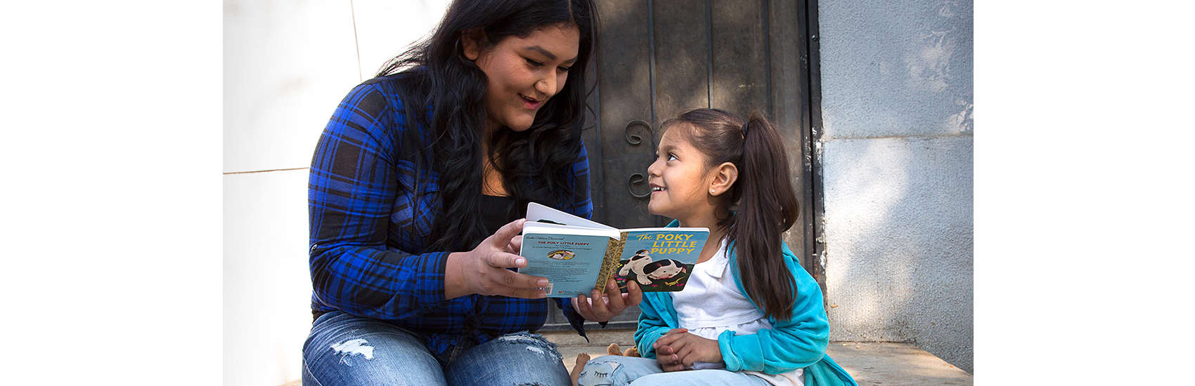 Rosa reads with her daughter, Surena, 4, during a home visit as part of Save the Children's signature Early Steps to School Success program in Central Valley California. Photo credit: Tamar Levine / Save the Children 2017.