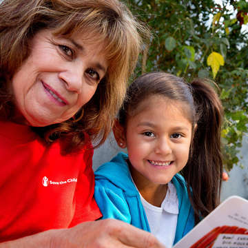 Early childhood specialist Diana Mata reads with Surena, 4, during a home visit as part of Save the Children's signature Early Steps to School Success program in Central Valley California. Photo credit: Tamar Levine / Save the Children 2017.