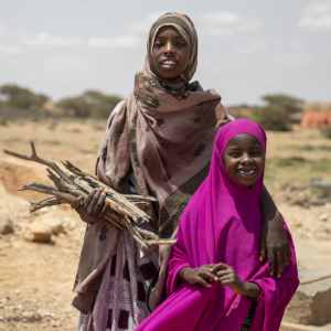 Two sisters hold firewood near their village in Somalia.