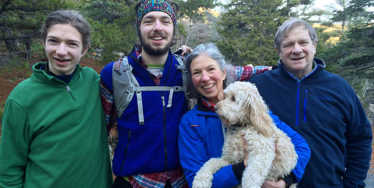 Forrest and Marcie Tyre Berkley pose for a photograph with their children and family dog. Photo Credit: Berkley Family 2015.