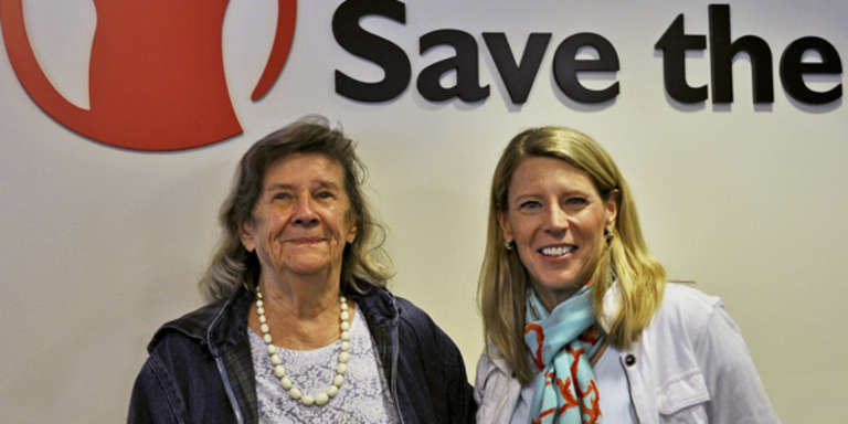 Janet Aley – a lifelong supporter of Save the Children – and Carolyn Miles, Save the Children's President and CEO, smile for the camera at Save the Children's headquarters in Fairfield, Connecticut. Photo credit: Save the Children.