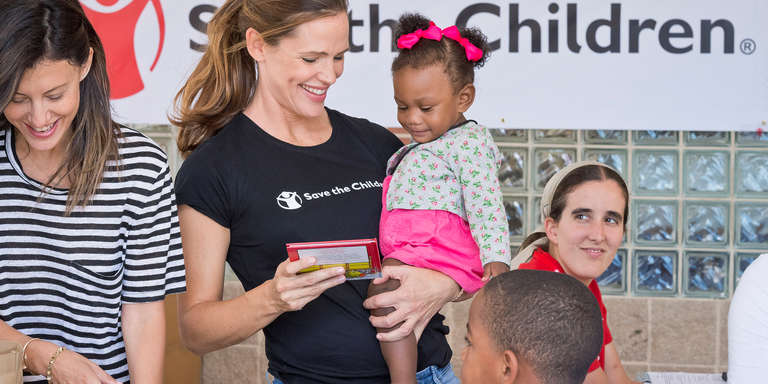 Jennifer Garner, Save the Children trustee and ambassador, holds a 1-year-old girl during a visit to Hilliard Elementary School in Houston, TX. The team surveyed the damage done by Hurricane Harvey and distributed childcare supplies and educational materials to locals. Photo credit: Anthony Rathbun/Save the children, September 2017, in Houston, TX.