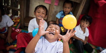 Children playing and learning at a Save the Children reading club in  Mindanao, Philippines.