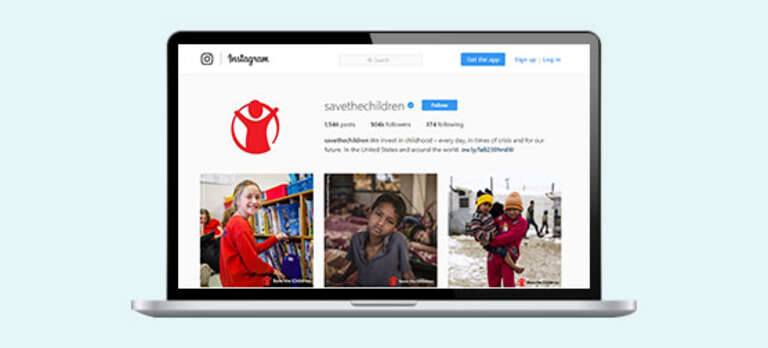 A computer showing Save the Children's Instagram feed