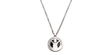 Since beginning its unique partnership in 2009 with Save the Children, Bvlgari has raised over $85 million globally through sales of an iconic Save the Children jewelry collection. This is a necklace with the Save the Children logo. Photo credit: Save the Children 2019.