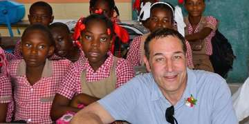 Sam Simon and Drew Carey visit a school in Haiti. Photo Credit: Save the Children 2014