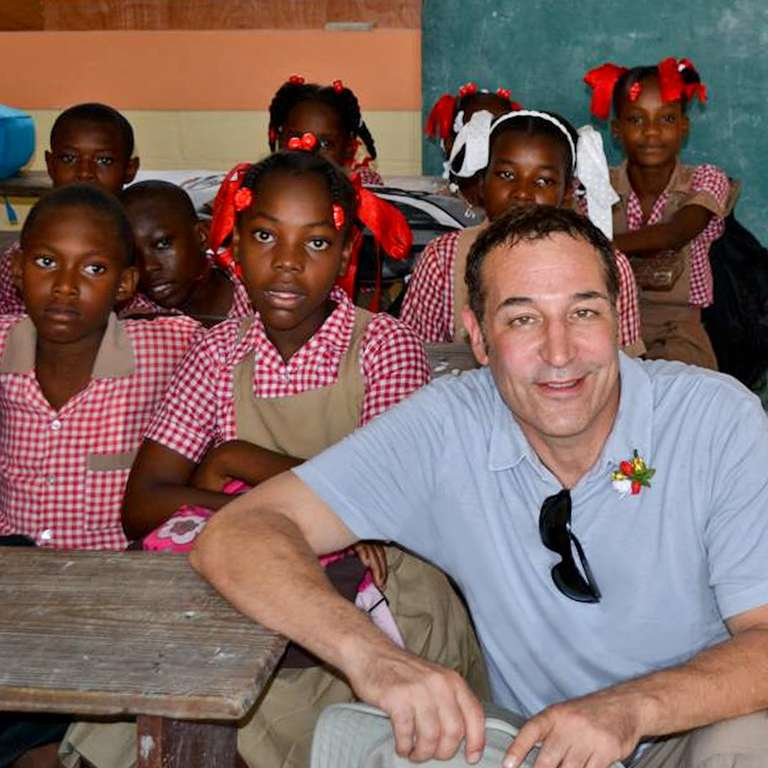 Sam Simon at a school in Haiti after the Earthquake. Photo Credit: Save the Children 2015.