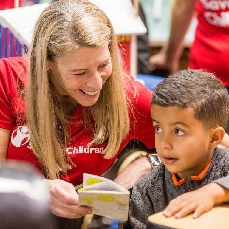 Carolyn Miles, President & CEO of Save the Children visits with children benefitting from the organization's Hurricane Maria emergency response efforts in Puerto Rico.