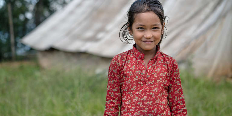 A 7-year-old girl poses for a portrait in Sindhupalchok, Nepal. Her village was badly hit by the 2015 earthquake, taking away lives, homes, and livelihoods, and putting the children here in further jeopardy of trafficking. She and her three sisters attend a child-friendly space where Save the Children field staff inform girls about child trafficking dangers. Suzanne Lee / Save the Children, August 2016.