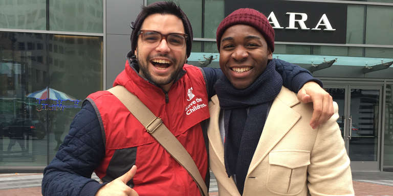 While fundraising for Save the Children, a canvasser from Up Fundraising, Josiah Potter, grins with a man on the streets of Seattle, Washington.