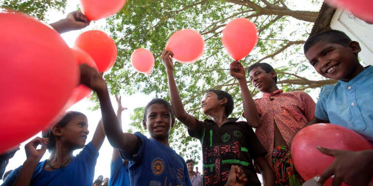Children play with balloons after the end of an interactive session with the children organised by Save The Children at the proposed site of the clinic at Pukra in Habigonj.