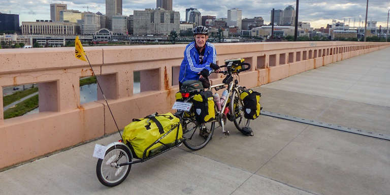 Alan Thompson poses with his bike and attached trailer in Ohio. Contributed photo/Save the Children, August 2015.