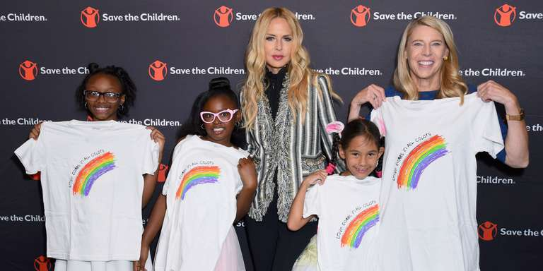 Artist Ambassador Rachael Zoe poses for a photograph with Save the Children President Carolyn Miles and children at the Illumination Gala. Photo credit: Save the Children, 2018.
